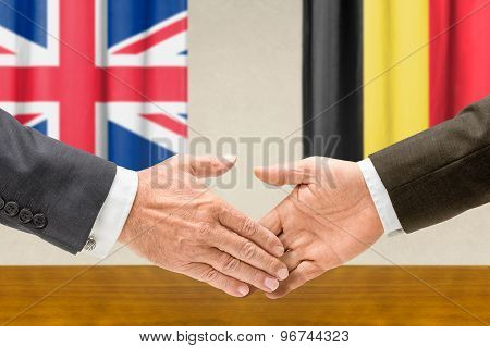 Representatives Of The Uk And Belgium Shake Hands