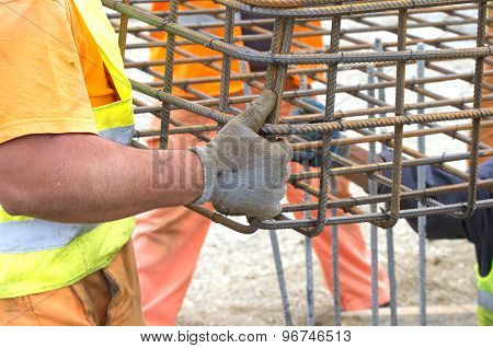 Workers Installing Reinforcement Structure