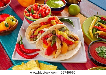 Chicken fajitas tacos mexican food guacamole pico de gallo chili peppes sauces