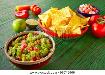 Mexican food nachos guacamole pico de gallo and chili peppers sauces