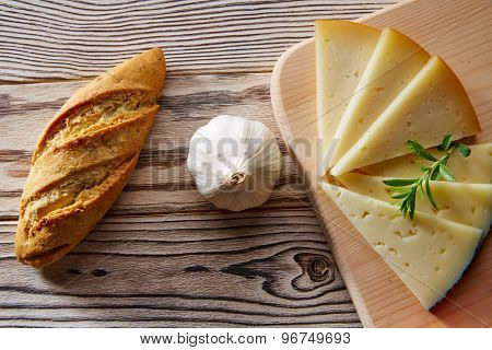 Mediterranean food bread loaf garlic and cheese slices on rustic wood