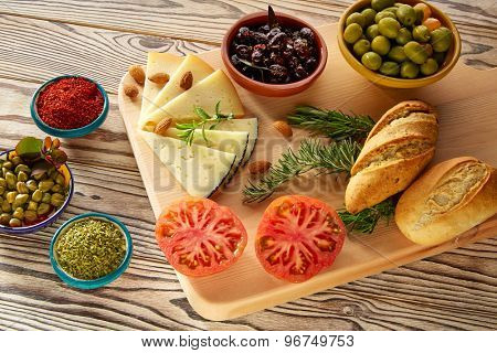 Mediterranean food bread oil olives cheese spices peppers garlic almods rosemary