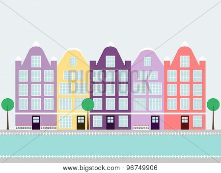 Cute colorful amsterdam houses on the water canal with trees.