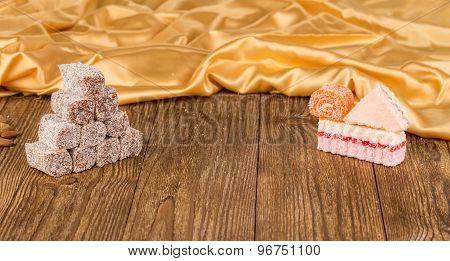 Sweet turkish delight on wooden table.