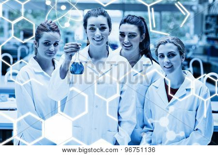 Science graphic against lab partners posing with a flask
