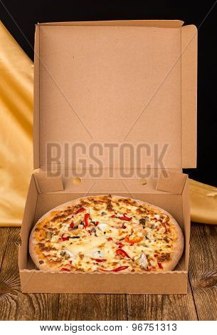Tasty pizza in box.