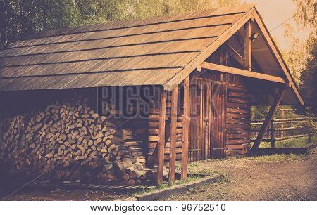 Wooden Shed And Logs