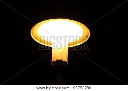 Bright yellow street light at night