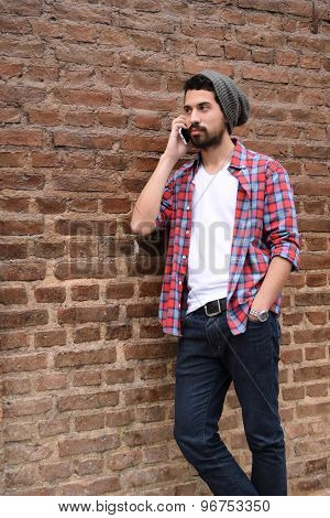 Young Man Talking On The Phone.