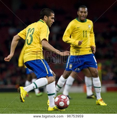 LONDON, ENGLAND. March 02 2010: Brazil's Daniel Alves and Robinho during the international football friendly between Brazil and the Republic of Ireland played at the Emirates Stadium.
