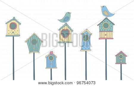 A set of cute bird houses and birds in a row