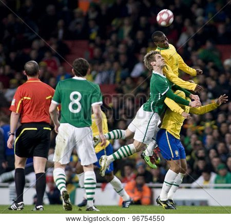 LONDON, ENGLAND. March 02 2010: Ireland's Kevin Doyle and Brazils Juan compete for the ball in the air during the international football friendly between Brazil and the Republic of Ireland
