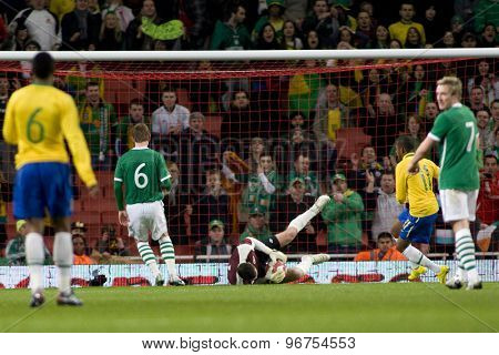 LONDON, ENGLAND. March 02 2010: Ireland's goalkeeper Shay Given stops a shot from Brazil's Robinho during the international football friendly between Brazil and the Republic of Ireland