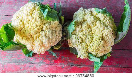 Fresh Organic Cauliflower On Old Wooden Background