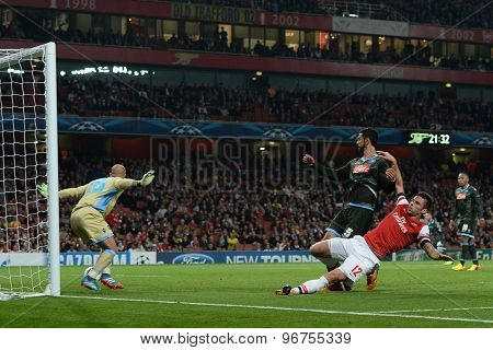 LONDON, ENGLAND - Oct 01 2013: Arsenal's  Olivier Giroud takes a shot at goal as Napoli's goalkeeper Pepe Reina watches the ball during the UEFA Champions League match between Arsenal and Napoli.