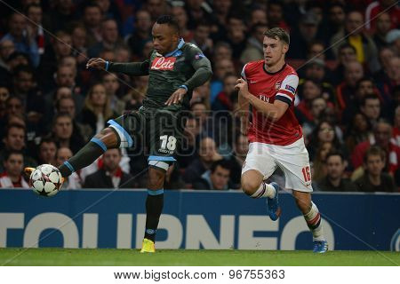 LONDON, ENGLAND - Oct 01 2013: Napoli's defender Camilo Zuniga from Columbia  and Arsenal's midfielder Aaron Ramsey from Wales  during the UEFA Champions League match between Arsenal and Napoli.