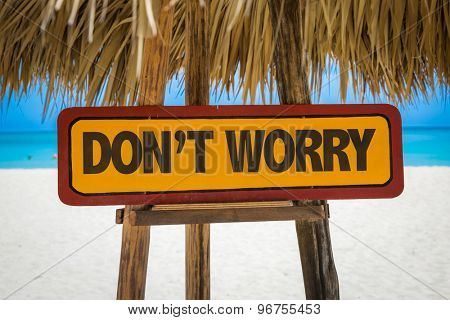 Don't Worry sign with beach background