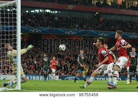 LONDON, ENGLAND - Oct 01 2013: Napoli's goalkeeper Pepe Reina makes a save from Arsenal's defender Laurent Koscielny during the UEFA Champions League match between Arsenal and Napoli.