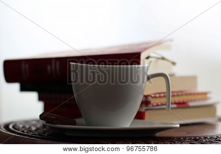 Cup of coffee and piece of chocolate