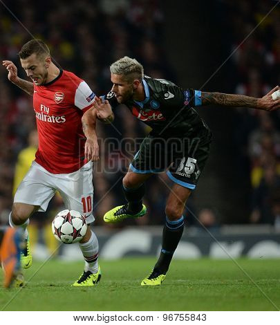 LONDON, ENGLAND - Oct 01 2013: Arsenal's midfielder Jack Wilshere from England  and Napoli's midfielder Valon Behrami during the UEFA Champions League match between Arsenal and Napoli.