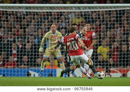 LONDON, ENGLAND - Oct 01 2013: Arsenal's midfielder Mathieu Flamini from France takes a shot at goal during the UEFA Champions League match between Arsenal and Napoli.