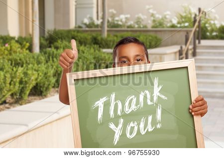 Happy Hispanic Boy Giving Thumbs Up Holding Thank You Chalk Board Outside on School Campus.