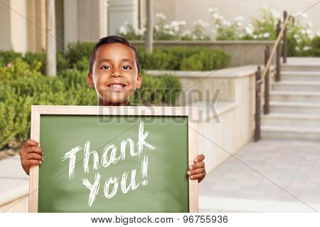 Happy Hispanic Boy Holding Thank You Chalk Board Outside on School Campus.