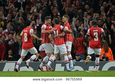 LONDON, ENGLAND - Oct 01 2013: Arsenal's midfielder Mesut Ozil from Germany  celebrates scoring a goal during the UEFA Champions League match between Arsenal and Napoli.