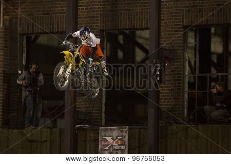 LONDON, ENGLAND. Aug 22 2009: Battersea London; Thomas Pages (FRA) emerges from the building to commence his first run while competing the Red Bull X Fighters International Freestyle Motocross