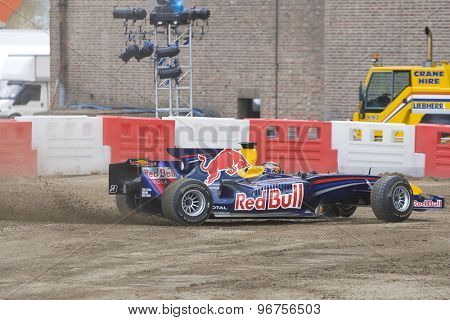 LONDON, ENGLAND. Aug 21 2009: Battersea London; Formula 3 racing driver Brendon Hartley (NZL) spins the Red Bull Formula 1 racing car during the Red Bull X Fighters International Freestyle Motocross