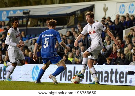 LONDON, ENGLAND - September 19 2013: Tromso's Morten Moldskred and Tottenham's Jan Vertonghen during the UEFA Europa League match between Tottenham Hotspur and Tromso played at The White Hart Lane