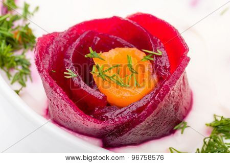 Cold soup with beets , carrots, yogurt and fresh herbs