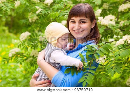 Cute Family Mother And Baby Outdoors
