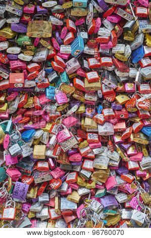 VERONA, ITALY - JULY 13: Cropped shot of gate filled with colourful padlocks in Juliet's House. July 13, 2015 in Verona.