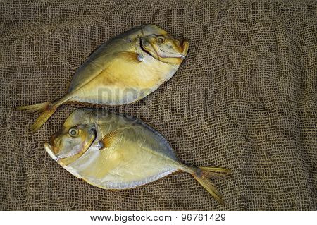Two Smoked Fish Vomer On Burlap Closeup