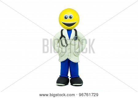 A happy emoticon dressed as a doctor and smiling made in plasticine