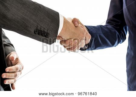 Confident Businessman Shaking Hands With His  Female Business Partner To Conclude A Deal