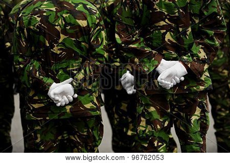 Soldiers In Camouflage Uniform With Hands Behind Backs