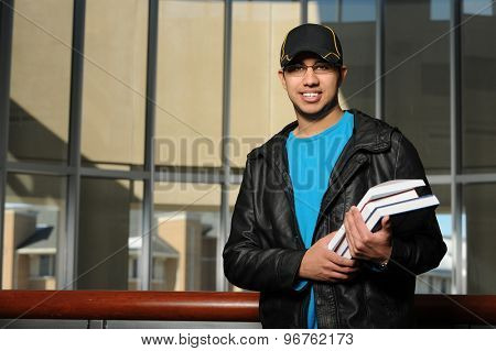 Portrait of ethnic college student inside building