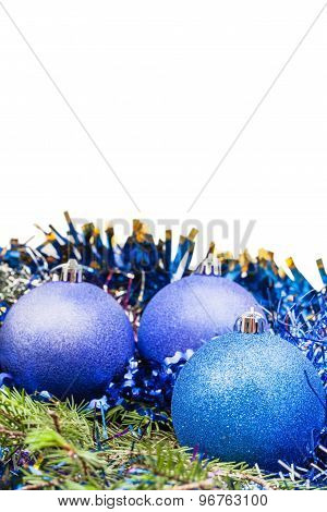Blue And Violet Xmas Balls On Green Spruce Branch