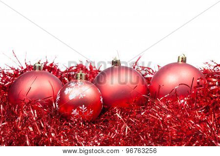 Four Red Christmas Balls And Tinsel Isolated