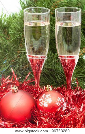 Two Glasses With Red Xmas Decorations And Tree 3