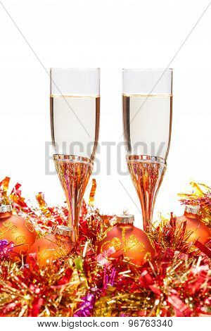 Two Glasses Of Champagne And Gold Christmas Bauble