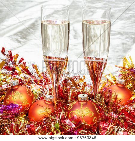 Glasses Of Sparkling Wine With Gold Xmas Baubles