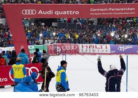 GARMISCH PARTENKIRCHEN, GERMANY. Feb 19 2011:  A french coach celebrates as Jean-Baptiste Grange (FRA) wins the mens  slalom race , at the 2011 Alpine skiing World Championships