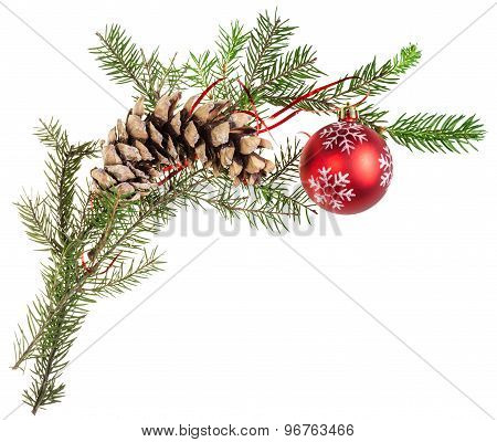 Branch Of Spruce Tree With Cone And Red Ball