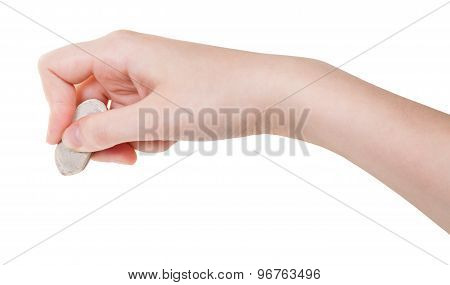 Hand With White Rubber Eraser Isolated On White