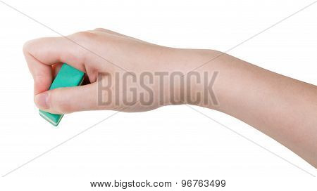 Hand With Green Rubber Eraser Isolated On White
