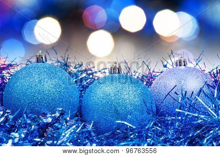 Xmas Blue Baubles On Blurred Blue Background
