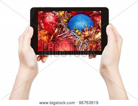 Take Photo Of Red Xmas Decorations With Tablet Pc